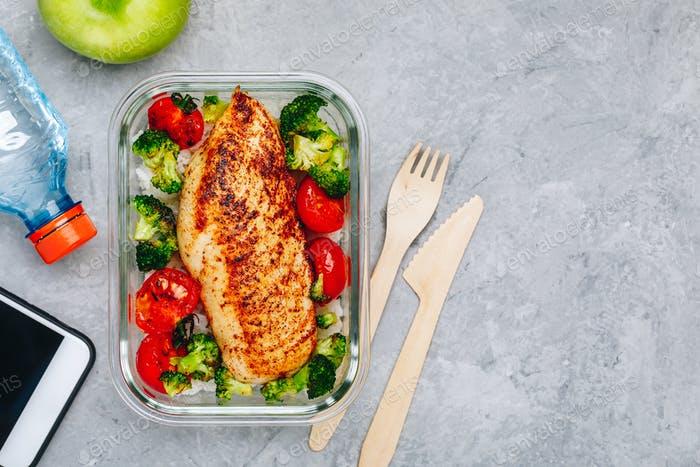 Grilled chicken meal prep containers with rice, broccoli and tomatoes.