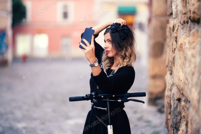 Portrait of cheerful girl smiling and taking photographs