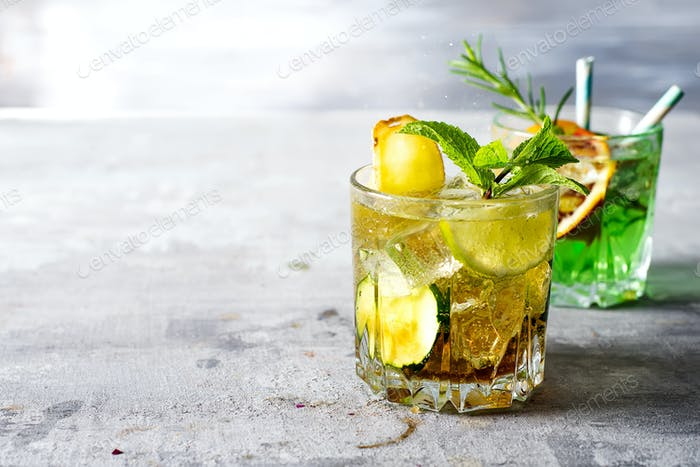 Cuba libre cocktail in a glass on a light stone background with copy space
