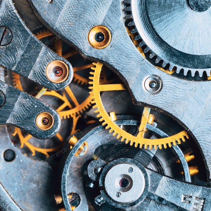 Close-Up Of Old Clock Watch Mechanism. Retro Clockwork Watch With Gearwheels Gears. Vintage Movement