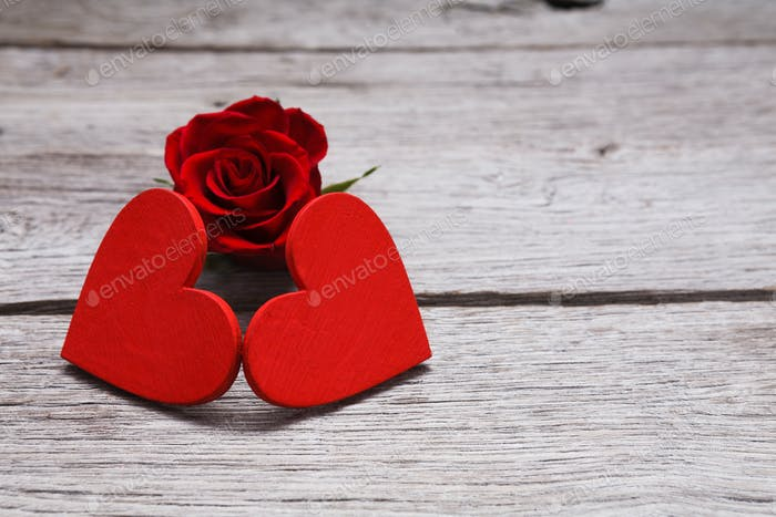 Valentine day background, handmade hearts on wood with rose