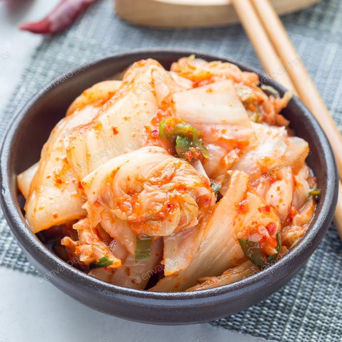 Kimchi cabbage. Korean appetizer in a ceramic bowl, square