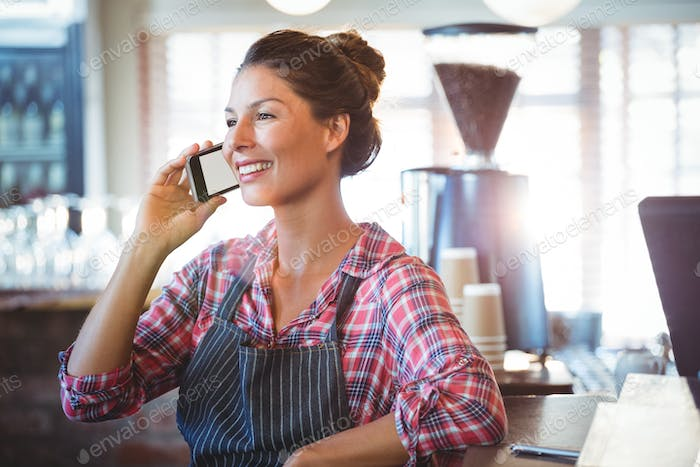 Waitress making a phone call