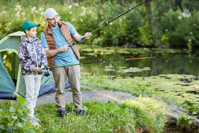 Man Teaching Boy Fishing