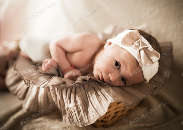 Little newborn girl with bandage on head