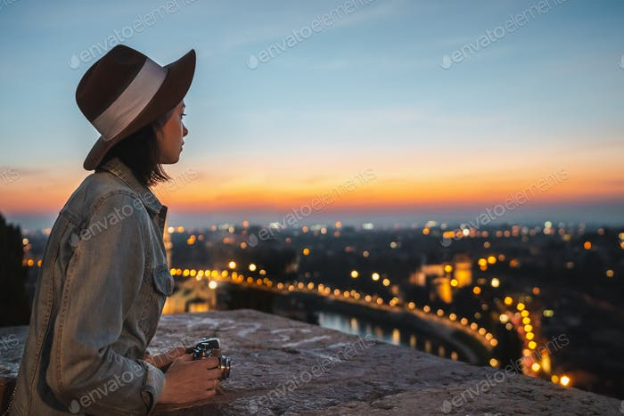 Young tourist looking at night view