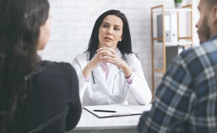 Female physician listening to her patients during consultation
