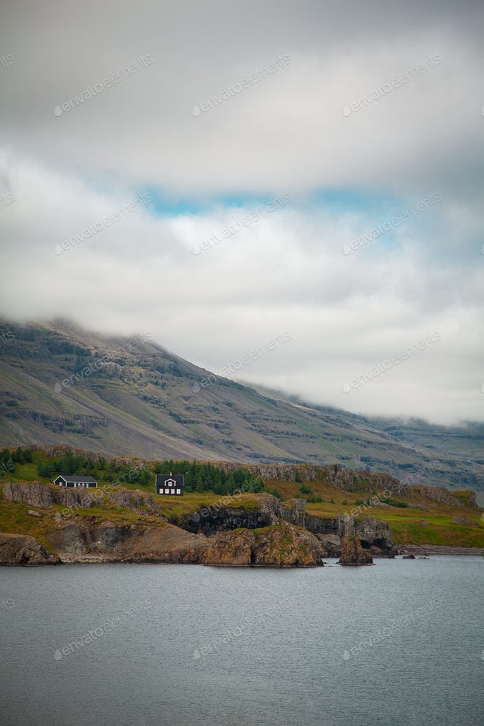 Cloudy mountains in Iceland near the river