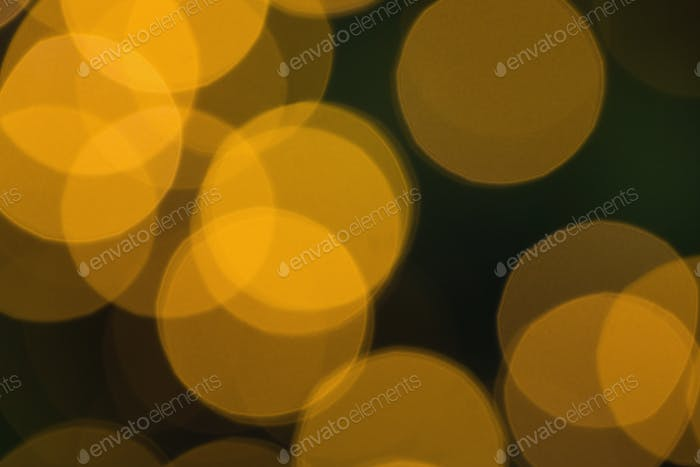 Blurry yellow christmas light circles close up