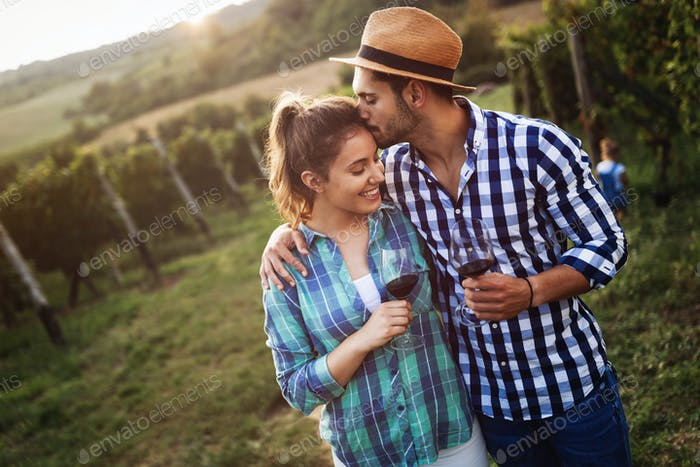 Romantic couple in vineyard before harvesting