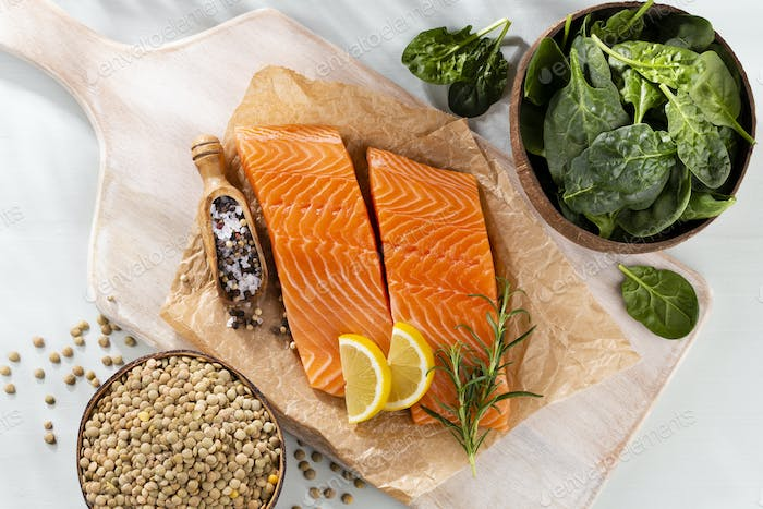 Fresh salmon steak with spinach and lentils.