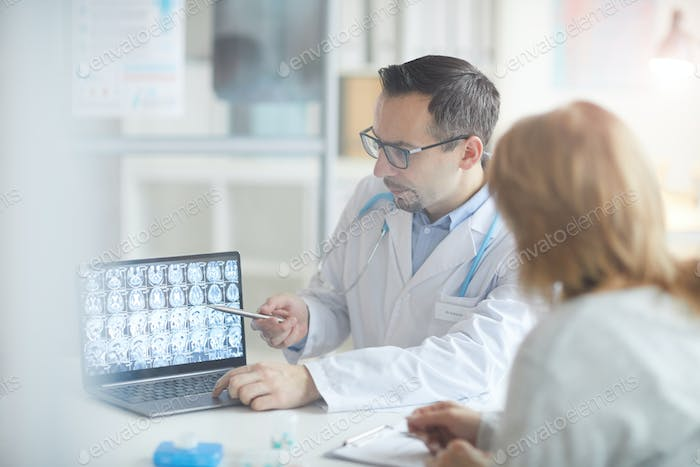 Doctor showing x-rays to patient