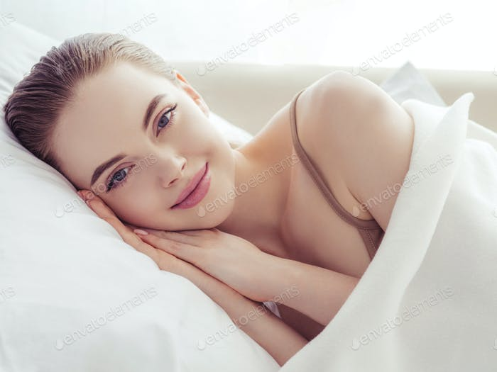 Woman sleep home in bed relax lifestyle