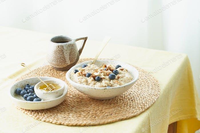 Breakfast, oatmeal porridge with berries and nuts, healthy food, proper nutrition.