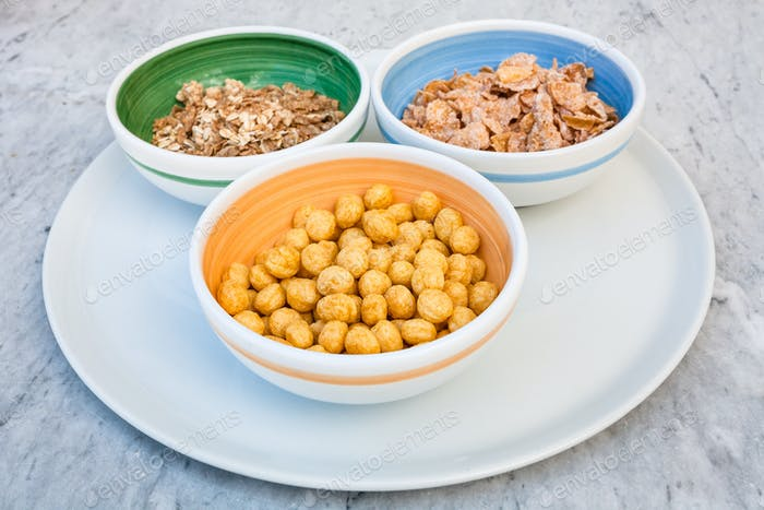 three kind of cold breakfast cereals in bowl