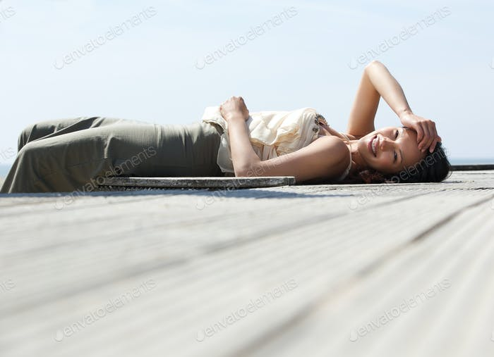 Cheerful young woman lying down
