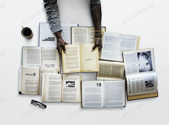 Human hand holding and reading book for research