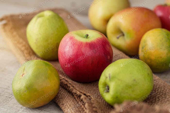 Red apples on sack
