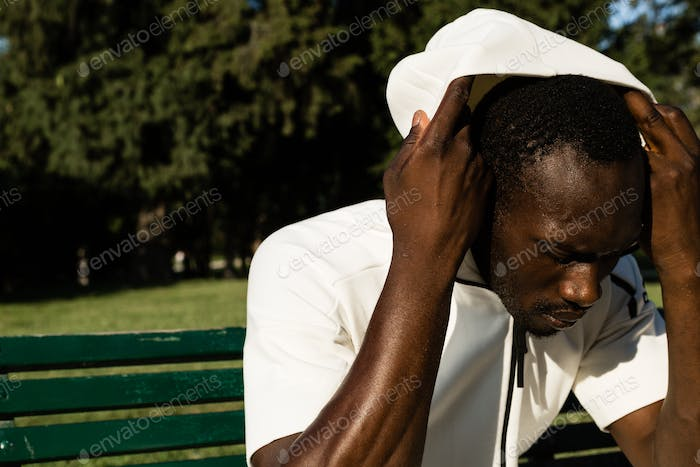 Portrait of a black man in a city park