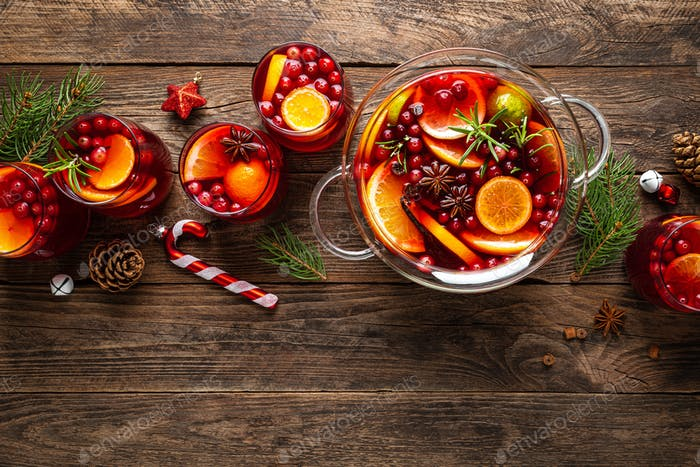 Christmas punch. Festive red hot toddy cocktail, drink with cranberries and citrus fruits
