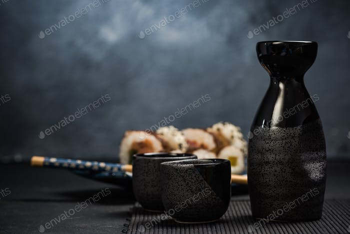 Drinking traditional sake and eating sushi