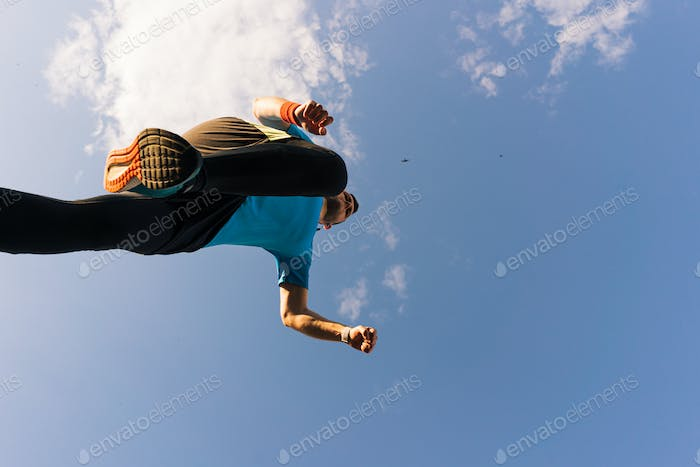 Sportsman runs and jump into the sky