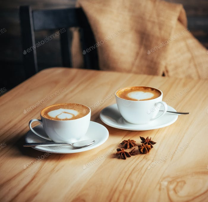 Two cups of gourmet coffee house cappuccino