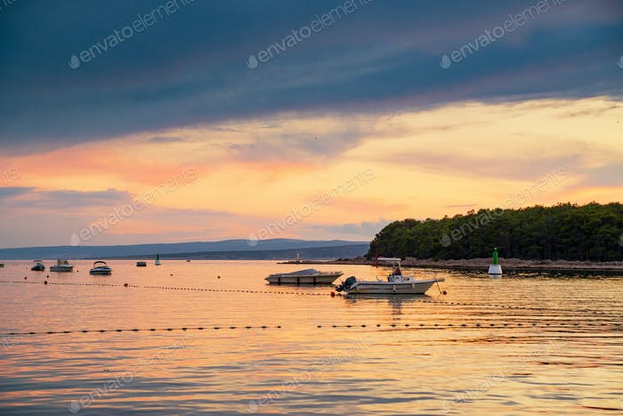 Boat at sunset in Adriatic sea