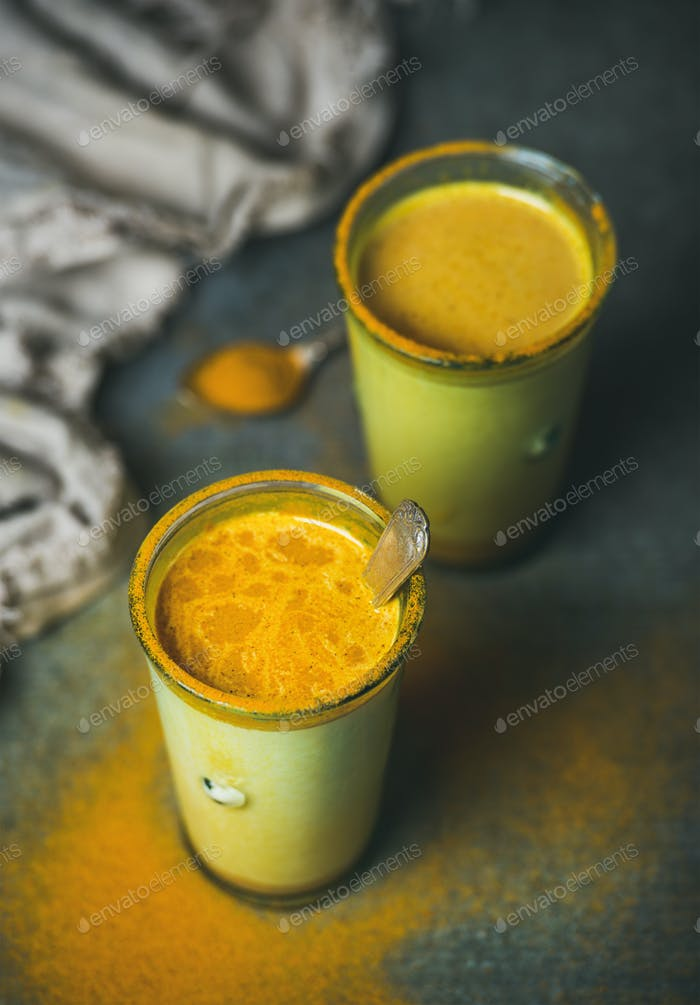 Golden milk with turmeric powder, natural cold fighting healthy drink
