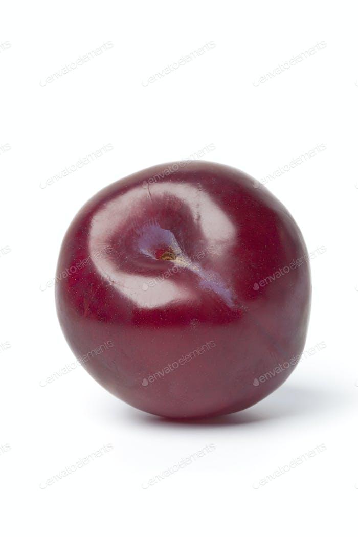 Whole single purple plum