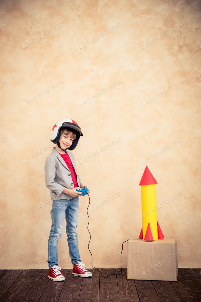 Child with toy paper rocket
