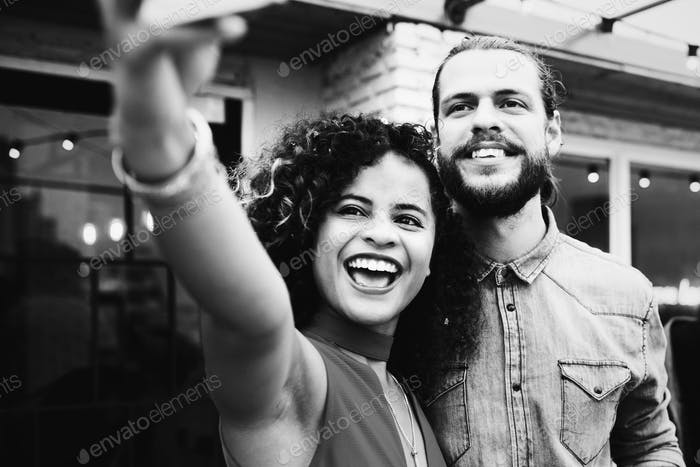 Couple taking selfie in a party