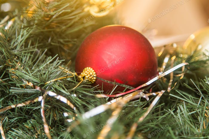 Red christmas decoration on the fir tree