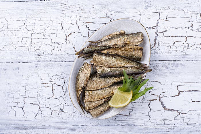 Canned smoked sprats in oil