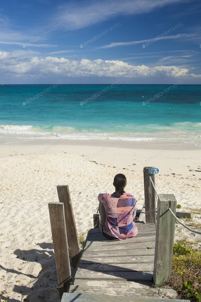 Woman looking over tropical beach