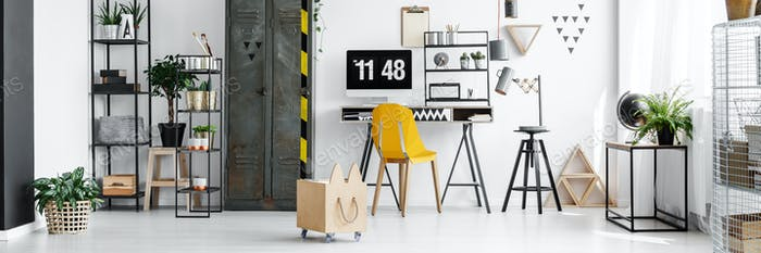Yellow chair and desktop computer