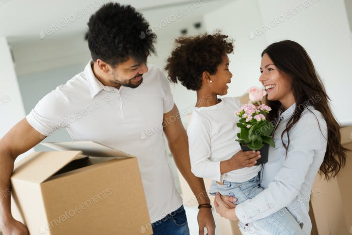 Happy family with cardboard boxes