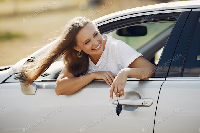 Elegant woman looks out of the car window