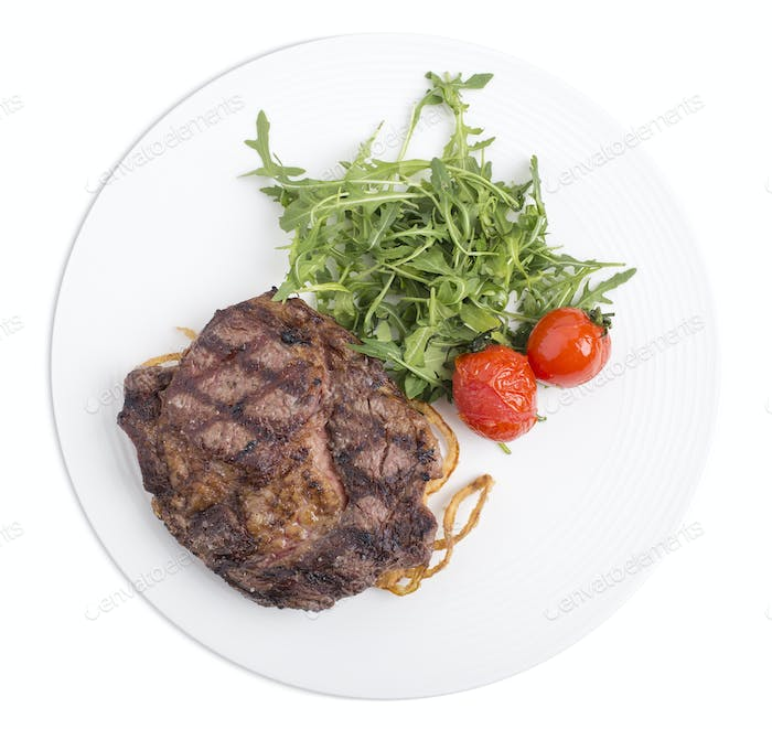 Delicious beef steak with arugula.