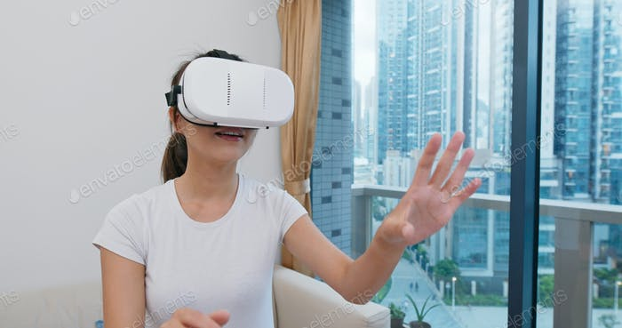 Woman wear VR device and play boxing at home