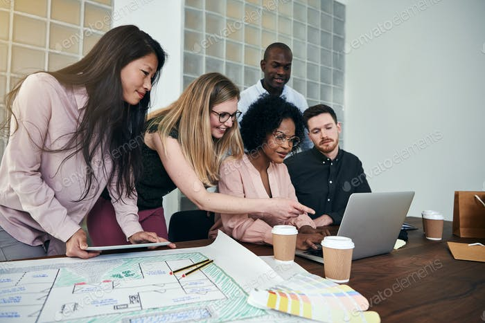Diverse group of designers working together in an office