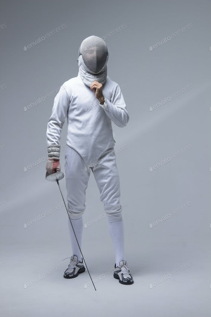 Portrait of a fencer in a fencing mask with a sword