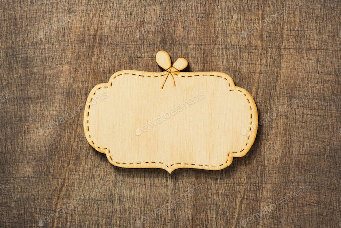 wooden sign board at wooden background
