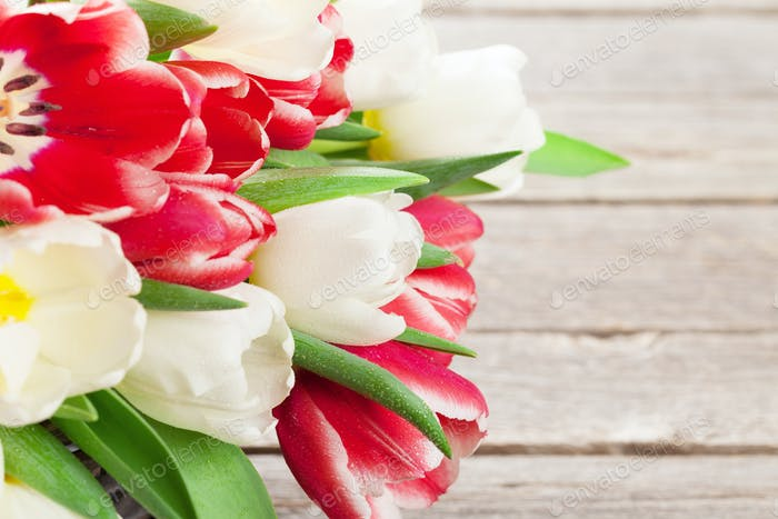 Colorful tulips bouquet basket