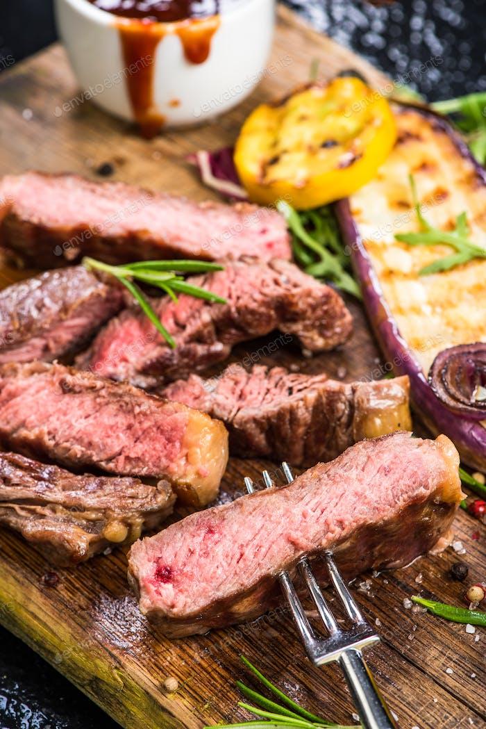 Medium rare beef steak grilled with veggie