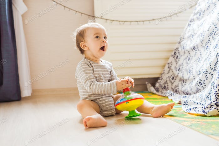 child boy toddler playing with toy indoors