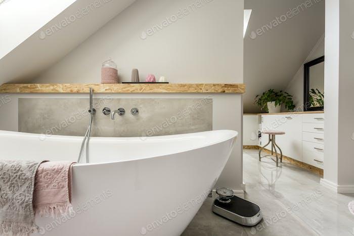 Freestanding bath in grey bathroom
