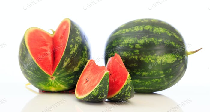 Sliced and whole watermelons isolated on white background
