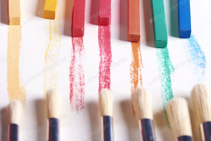 Top view of brushes and chalks