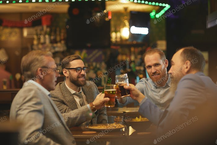 Men with drinks in the pub